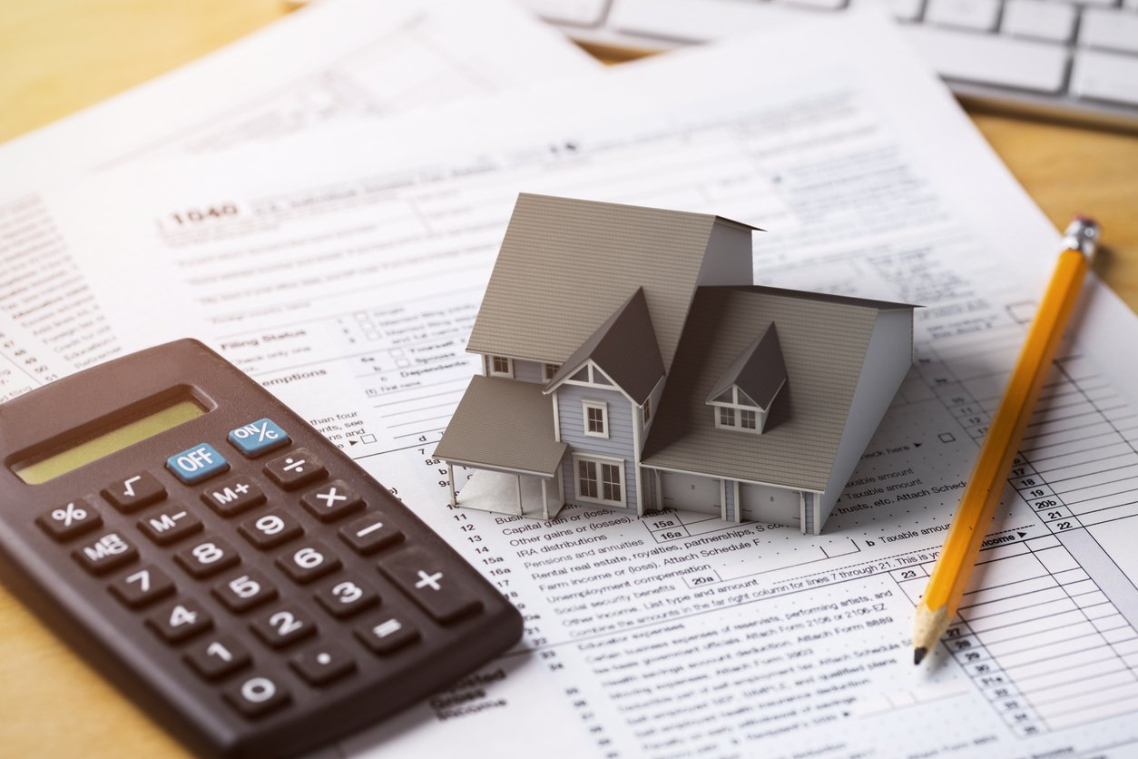 mortgage paperwork and calculator
