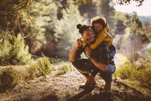 Father-giving-son-a-piggyback-ride-in-nature-300x200 Mortgage Retirement Loan