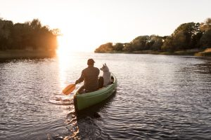 Man-in-canoe-with-dog-at-sunset-300x200 Savings Rates