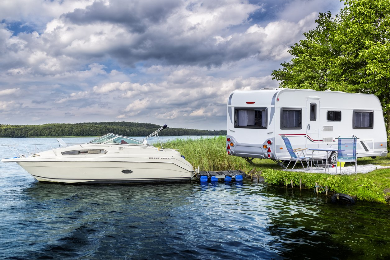 RV Parked Next to Lake when Boat is Docked