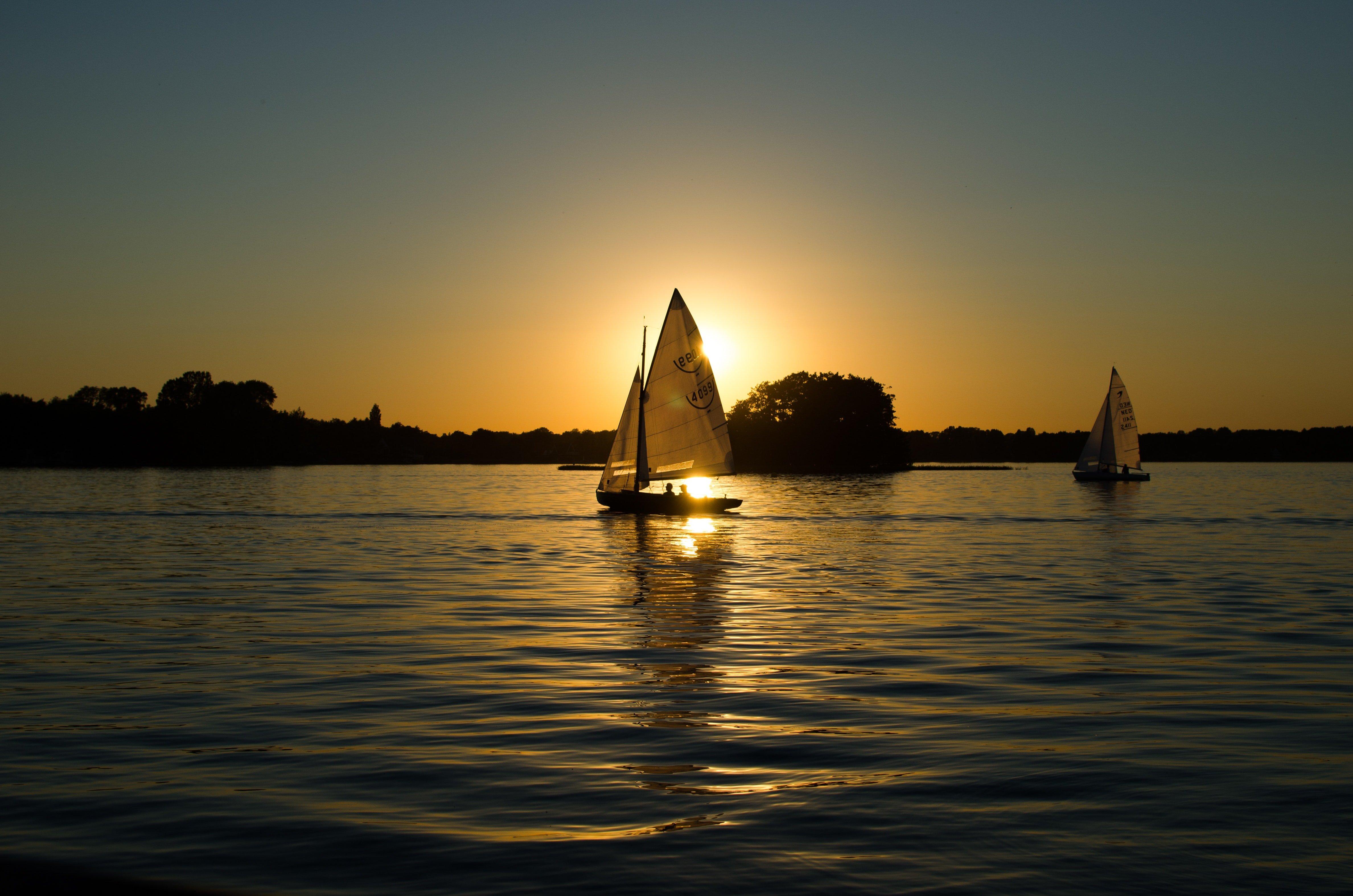 Sailboats sailing at dawn
