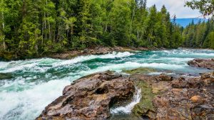 water-flowing-through-a-river-with-a-rocky-shore-300x169 Checking