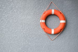 Orange Life Preserver On Gray Wall