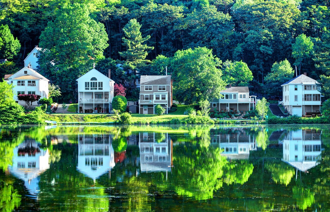 House Reflecting on a Small Pond