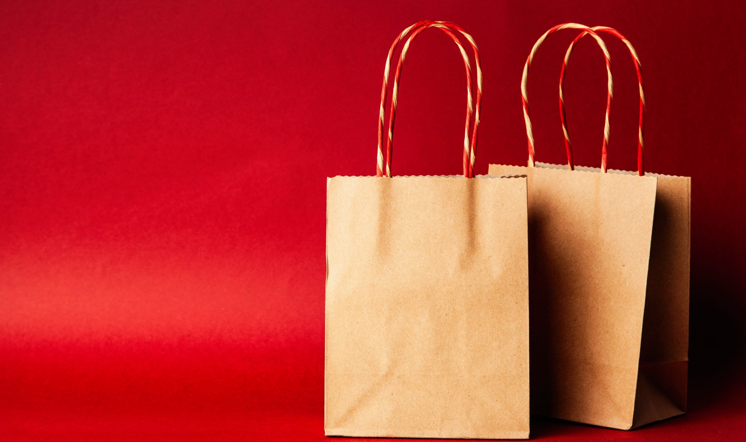 shopping bags on red background